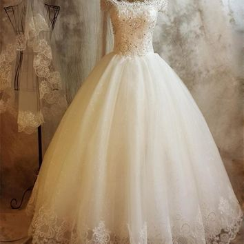 Ball Gown Princess Wedding Dresses 2017 Off Shoulder Short Sleeve Beaded Sequins Lace Tulle Ball Gown Princess Bridal Gowns