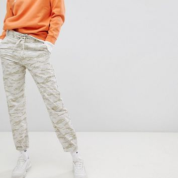 Carhartt WIP Relaxed Fit Trousers In Camo at asos.com