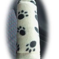 1 pair of fleece paw print car seatbelt pads white and black