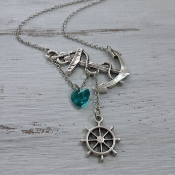 Lost Heart at Sea Necklace by SBC Silver Plated Anchor, Teal Swarovski Heart, Ship Wheel, Anchor Heart Necklace, Sideways Anchor, Teal Heart