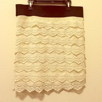 A cream/off white lace skirt