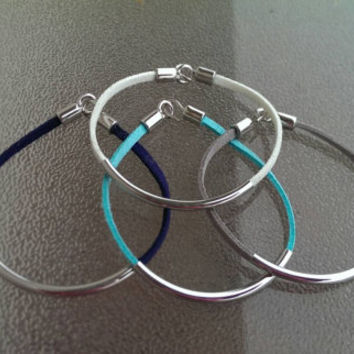 Faux suede and metal detail bracelet in navy, white, teal, and gray