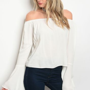 Long bell sleeve off the shoulder tunic blouse.