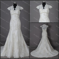 Cap sleeves winter wedding dress with sequins and appliques