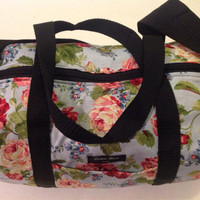 Floral duffle bag with adjustable strap