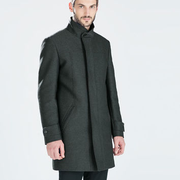 Diagonal funnel neck coat