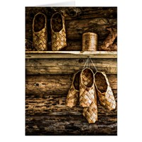 Bast shoes on the wall card