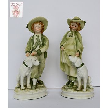 Pair Vintage Parisian French Country Figurines Boy and Girl with Dogs Green Hand Painted