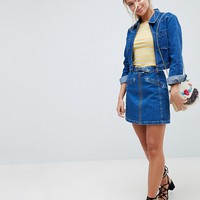 ASOS DESIGN denim skirt with western buckle detail co-ord at asos.com