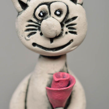 Handmade porcelain figurine painted with glaze and acrylics Cat with Rose