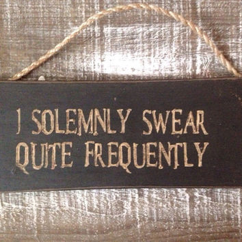 harry potter wood sign. i solemnly swear. quite frequently.