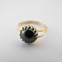 Delicate gold ring with a mystic black stone by vestigiafortunae