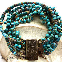 Turquoise and earth tone Czech Picasso glass and wood multi-strand bracelet.