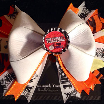 "Custom Volleyball bow with 7"" spikes. Made from VolleyLite ball"