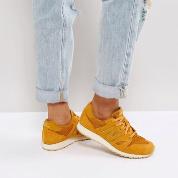 New Balance 520 Mustard Suede Trainers With Metallic Trim at asos.com