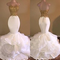 Sexy African White and Gold Prom Dresses Mermaid 2017 Spaghetti Strap Appliques Lace Ruffles Organza Backless Evening Gowns