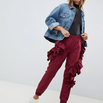 ASOS DESIGN ruffle joggers in burgundy at asos.com