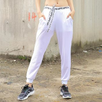 Mesh Hollow out sports women trousers  Loose breathable Dance training Running  fitness pants Lace-up LOVE printing yoga pants