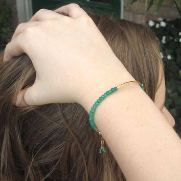 Shaded green gemstone bracelet with gold tube, ombre bracelets, May birthstone