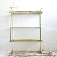 Vintage gold metal 3 tier shelf with towel rack // shabby chic filagree wall hanging