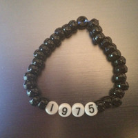 The 1975 band beaded bracelet