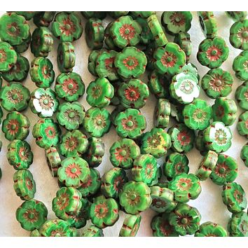 Ten Czech glass flower beads - 10mm opaque marbled silky green picasso Hawaiian flowers - table cut, carved floral beads C10101