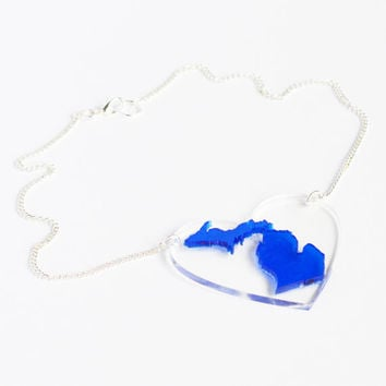 Transparent blue laser cut acrylic Michigan state pendant charm statement necklace on clear acrylic heart base and silver or gold curb chain