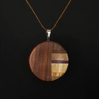Wooden pendant. Round, circle, coin made of different kinds of wood. Pendant Amulet Charm. Unique handmade jewelry. Wood carving wood Craft.