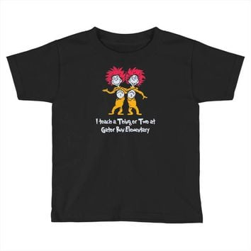 i teach a thing or two at gator run elementary Toddler T-shirt