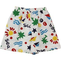 Barbara Gerwit 80's Vintage Shorts: 80s -Barbara Gerwit- Womens white background with red, blue, green, yellow and teal palm, sun, -Sea- and wave print cotton board short length casual beach shorts with elastic waistline and two inset hip pockets.