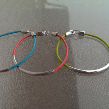 Colored leather and metal detail bracelet in bright green, coral, and blue