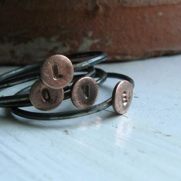 Initial Rings of dark silver and copper