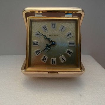 Vintage 1980's Bulova wind up travel alarm clock white leather case gold tone