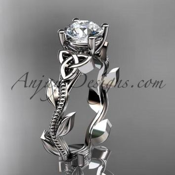 "14kt white gold celtic trinity knot wedding ring, engagement ring with a ""Forever One"" Moissanite center stone CT7238"