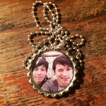 Danisnotonfire and Amazingphil YouTubers together picture bottlecap necklace