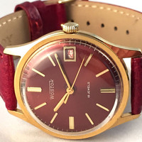 USSR Soviet Russian men's VOSTOK watch ,18jewels movement with date on the dial, great Vintage watch, new leather band.