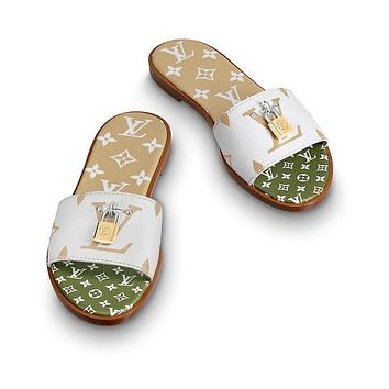 3ff9e5d6ae70 Louis Vuitton LV Lock It Mule Sandals