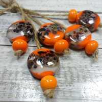 Lampwork.Glass bead handmade. Beads yellow, gray, brown.