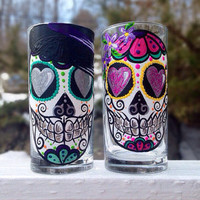 Sugar skull couple drinking glasses