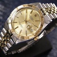 Vintage 1970's Rolex Oyster Perpetual Thunderbird in 14k gold & stainless steel