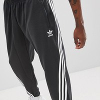 adidas Originals Nova Wrap Around Joggers In Black CE4806 at asos.com