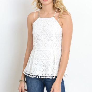 lace peplum top with pom pom trim