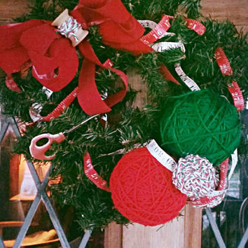 Christmas Crafter's Wreath. Pine Base Studded with Sewing Notions, Yarn Balls, Sewing Tape and Velvet Red Bow.
