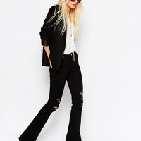 ASOS PETITE Bell Flare Jeans in Clean Black with Thigh Rips at asos.com
