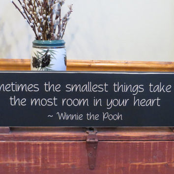 Sometimes the smallest things take up the most room in your heart, Winnie the Pooh wood sign