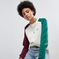Fila Oversized Boyfriend Sweatshirt With Colourblock Sleeves at asos.com