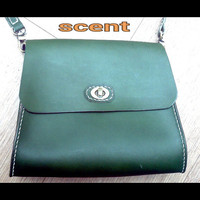 womans leather cross body bag green