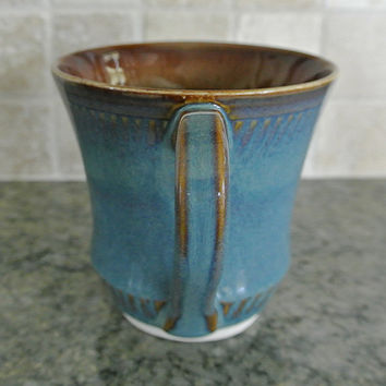 Pottery mug, 12 oz. Hand thrown porcelain coffee mug, this handmade pottery cup is hand thrown on a pottery wheel with blue and brown glaze