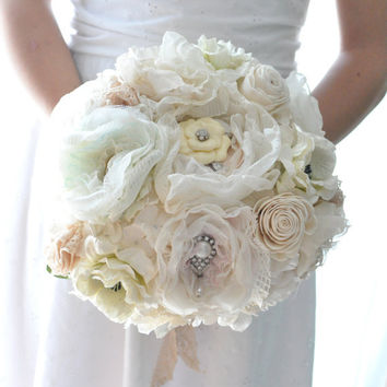 Vintage wedding bouquet, oldworld charm of lace and pearls among paper flowers and seafaom, blush pink and pastel peach fabric flowers