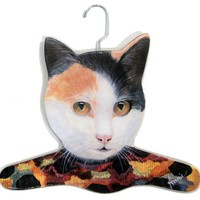 The Stupell Home Decor Collection Calico Cat Wearing Printed Dress Hanger